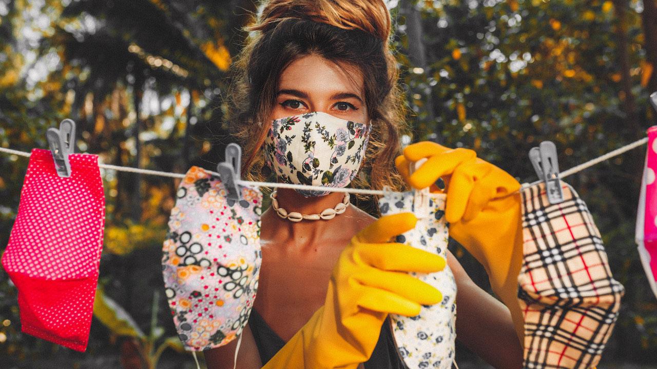 lady hanging up masks concerned for immune system